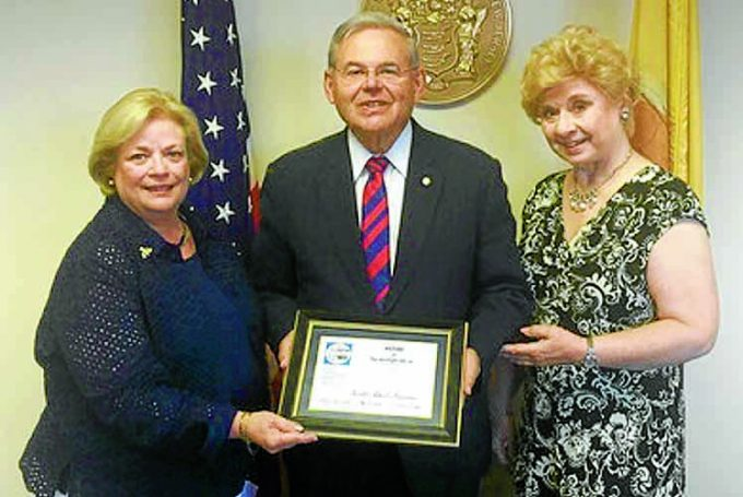 AWARD . . .  senator Bob Menendez received the award from Mary Kay Stratis, left, and Joan Dater, right