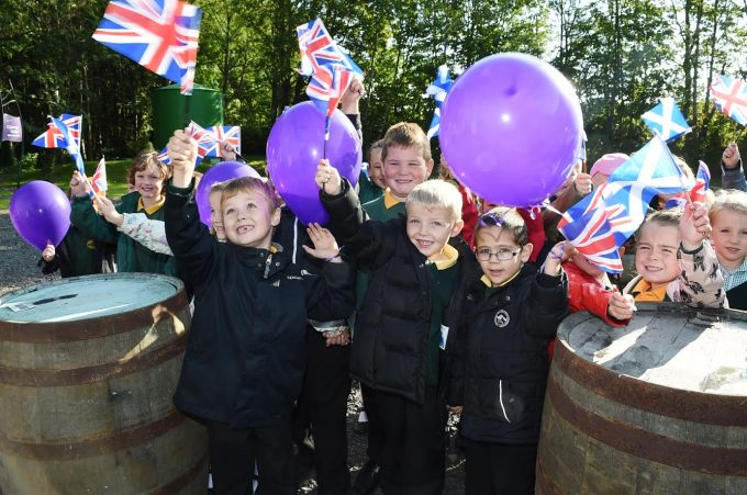 ROYAL WAVE . . . children from Elmvale Primary