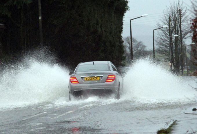 SPLASH . . . water on the A711 this morning