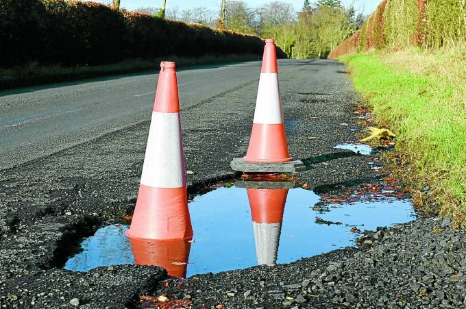 wqe *** Local Caption *** BLACK HOLE . . . another pothole spotted this week on the B7020 near Lochmaben