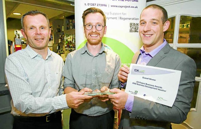 John Grierson, Chapelcross Closure Director, presenting awards for Best Employer and Overall Winner to Creatomatic (Kit Allen, James Miodonski) *** Local Caption *** DOUBLE DELIGHT . . . John Grierson, of Magnox, presenting awards for Best Employer and Overall Winner to Creatomatic's Kit Allen, centre, and James Miodonski, right