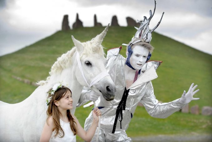 """FREE PIC - Crawick Multiverse Solstice Events Preview, Sanquhar, Dumfriesshire, Scotland, 19/06/2016:An extraordinary fusion of art, science and entertainment takes place this weekend (Friday 24th to Sunday 26th June 2016) at a three day celebration of the Summer solstice at the Charles Jencks designed Crawick Multiverse (correct), near Sanquhar, Dumfriesshire, Scotland.   Pictured rehearsing for the event are Lewis Sherlock from fantasy performance arts company Oceanallover (correct, from Moniaive, Dumfriesshire) with Murran Thin-Smith (correct, aged 10, from Lochmaben, Dumfriesshire, Scotland, pictured with parent's permission), and Charlie the Unicorn - pictured at """"The Andromeda Galaxy"""" section of the 55 acre landscape installation, which was created from the site of a former open cast coal mine.  More info from: PR consultant Matthew Shelley - 07786 704 299 - MJHShelley@hotmail.co.uk  ; more Crawick Multiverse info on: www.crawickmultiverse.co.ukFree FIRST USE (ONLY) picture.Photography from:  Colin Hattersley Photography - colinhattersley@btinternet.com - www.colinhattersley.com - 07974 957 388"""