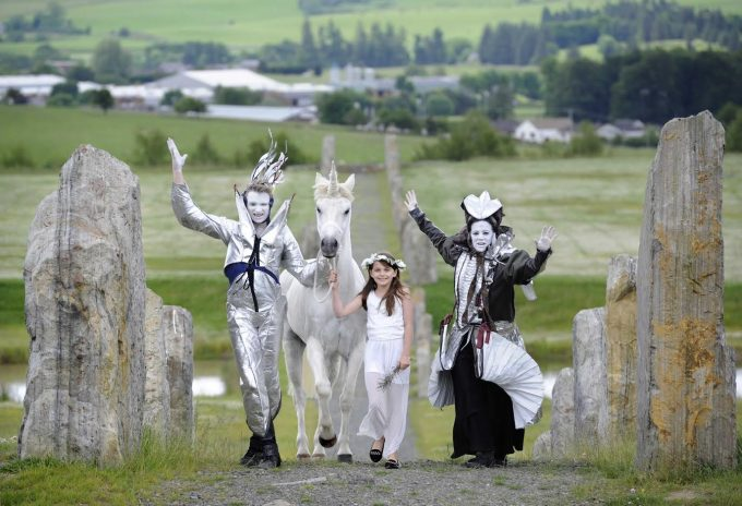 Lewis Sherlock, left, and Florence Garcia Chafuén from fantasy performance arts company Oceanallover in Moniaive prepare for this weekend's festival. Also pictured is with Murran Thin-Smith, from Lochmaben and Charlie the unicorn