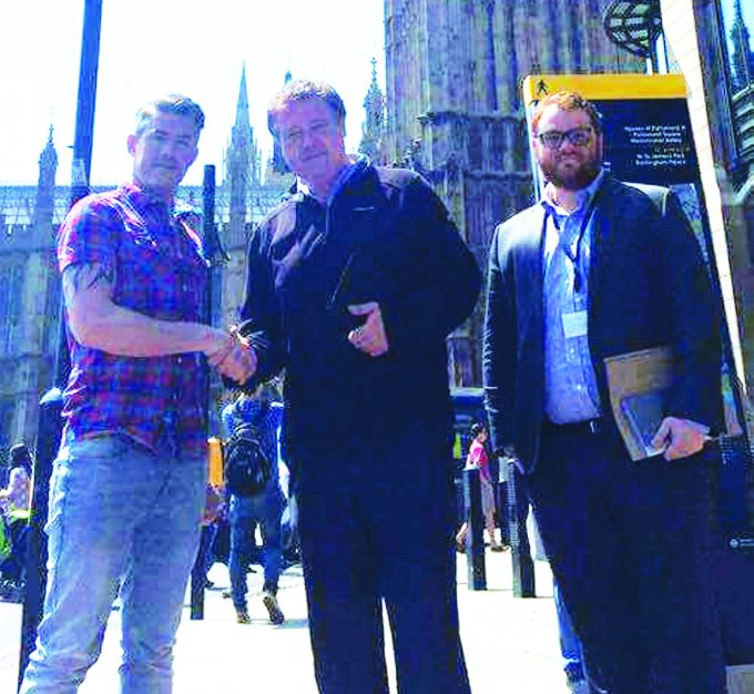 LONDON MEETING . . . left to right: campaigner Michael Porter with Richard Arkless MP and his Parliamentary assistant Anastasios Vourexakis