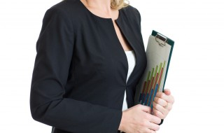 Smiling business woman holding clipboard in hands isolated over white