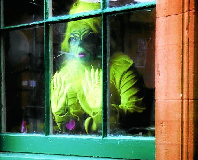 grinch *** Local Caption *** GREEN PERIL . . . Christmas is safe after The Grinch got himself locked inside Moat Brae house in Dumfries. The popular Dr Seuss creation was left behind after a weekend of festive fun. And there'll be no escape as the Georgian property has now closed ready for its transformation into the National Centre for Children's Literature and Storytelling. It won't reopen until 2018. See report, page 9