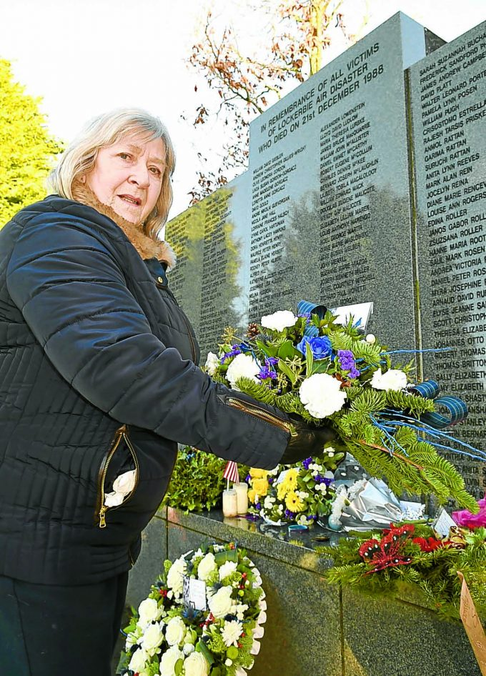 RESPECT . . . Doreen Jenkins, of Lockerbie Community Council, lays a wreath on behalf of the town