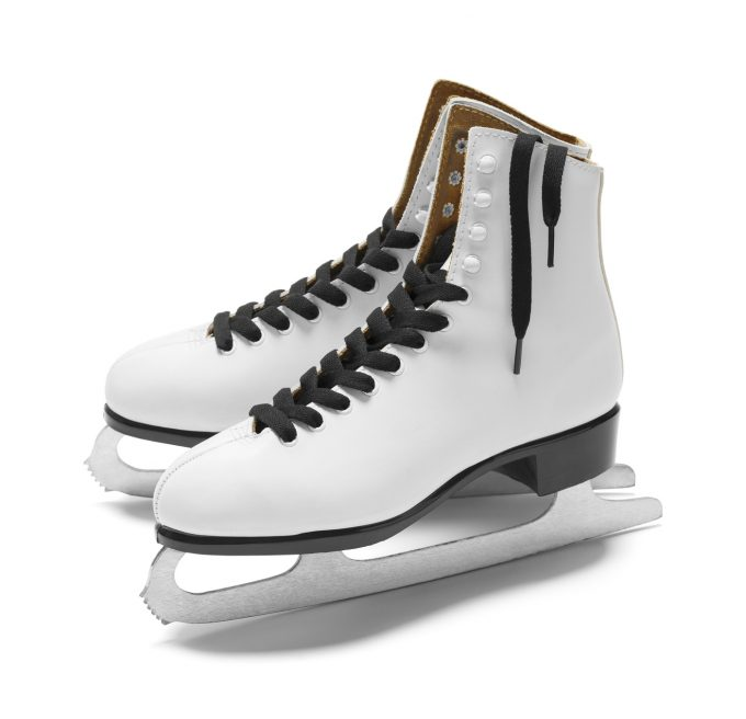 Pair of Women's Figure Ice Skates Isolated on White Background.