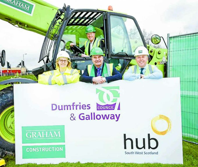 HUB WORK BEGINS . . .  the first sod is cut on the construction of new multi-million pound learning facility The Bridge in Dumfries. Pictured in the cab is Dumfries and Galloway Council Leader Councillor Ronnie Nicholson, with front, left to right: Hub South West Construction manager Alison Wilson, chairman of the councilÕs children, young people and lifelong learning committee Councillor Jeff Leaver, and GRAHAM Construction Framework director Craig Bridges