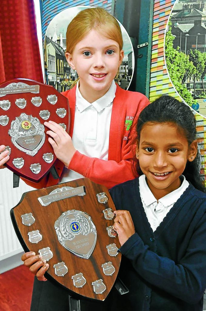 civic pride rt *** Local Caption *** YOUNG WINNERS . . . left to right: acrostic poem winner Iona Dillon from Troqueer Primary and colouring winner Erina Hamilton from Brownhall Primary