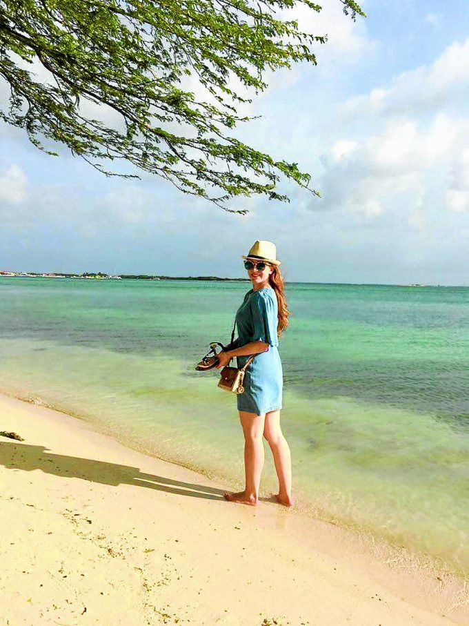 SCENERY . . . Corinne Smith from Annan walks on the sands of a Caribbean beach during time away from work on the ship