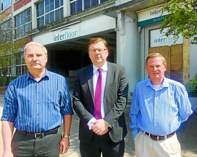 CALL FOR ACTION . . . left to right: Lochar Ward councillor Jeff Leaver, MSP Colin Smyth and local resident Brian Little at the former Interfloor factory in Dumfries