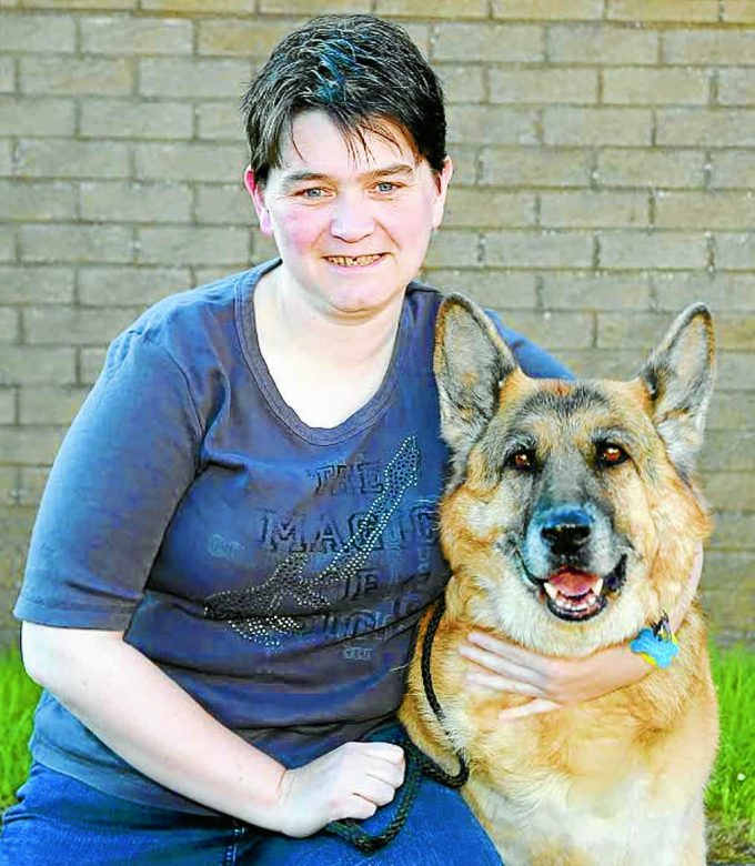 UNITED . . . Susan Wright of Dumfries is grateful to the fire and rescue team who came to the rescue of her pet German Shepherd Sabre