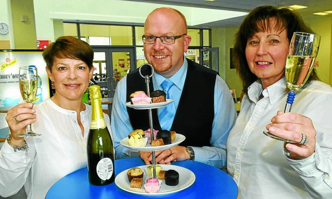 ret *** Local Caption *** CHEERS AND CAKES . . . lunch organisers Tracey Wright, right, and Christine Muirhead with rector Brian Asher