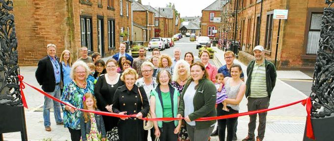 TOTAL TRANSFORMATION . . . Queen Street residents are all smiles as Dumfries and Galloway Council leader Elaine Murray prepares to cut the ribbon