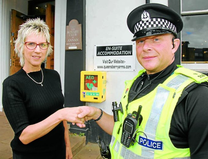 HEART lifesaver  *** Local Caption ***  LEGGED IT . . . Tracy Shaw, manager of the Queensberry Arms Hotel, congratulates PC Ian Leggett on his quick-action after he raced a defibrillator from the hotel to a heart attack victim