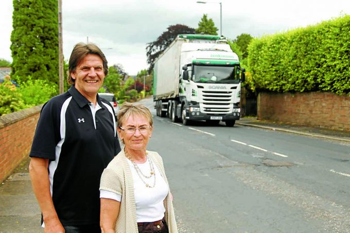 ROAD FEARS . . . Keith Gristwood and Valerie Coltart are among the Dalbeattie Road residents who have voiced concerns about council plans to introduce a cycle lane and yellow lines on the busy main road