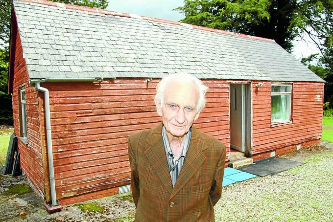 PLANNING PROBLEMS . . . Ronald Edgar in front of the wooden house at the centre of a planning row