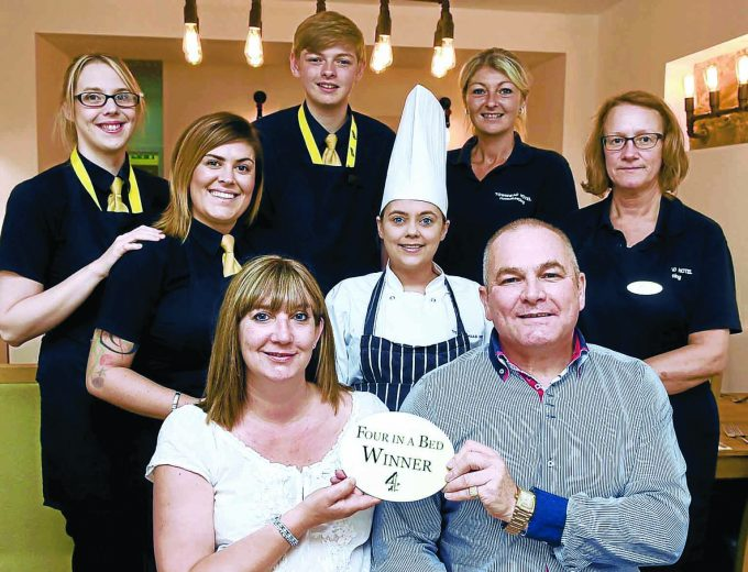we *** Local Caption *** TOWNHEAD ON TOP . . . Stephen Montgomery, Jan Livingston and staff are over the moon