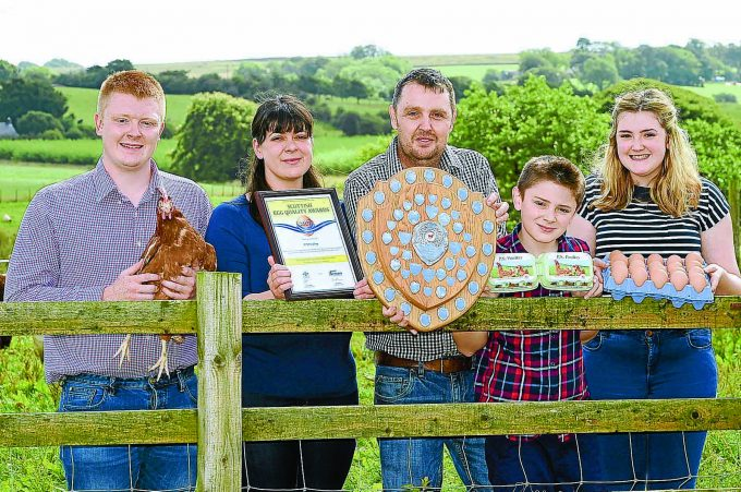 "waterbeck hen award *** Local Caption *** EGGS-CELLENT . . . a poultry farming family from Annandale are celebrating success in the Scottish Egg Quality Awards. Paul and Shona Arthur, of PS Poultry in Waterbeck, have been crowned the best producer 2017. They picked up their shield and trophy at a ceremony in Perth last month, organised by For Farmers. Shona, 39, said: ""We are delighted to win, it's a prestigious industry award and hard earned. ""We have 26,500 hens and we pack around 200,000 eggs per week. It's non-stop and we pride ourselves on a quality product, something that this award underlines."" The couple are pictured with their children, left to right: Ryan, Shona, Paul, Jamie and Catriona"