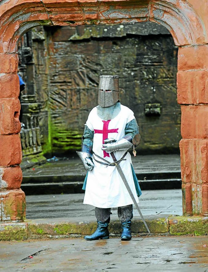 MEDIEVAL TIMES . . . a knight guards Lincluden Abbey