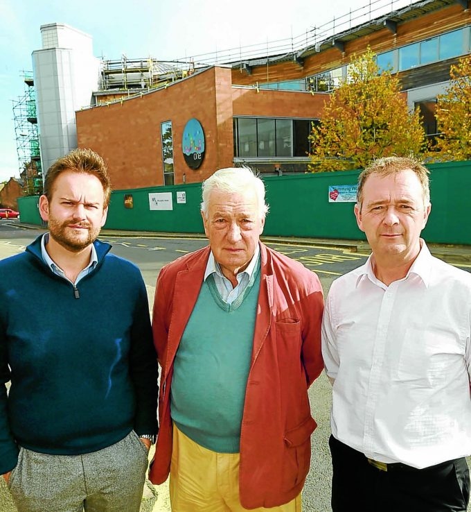 dg one dn *** Local Caption *** CONCERNS . . . left to right: councillors Matthew Ronnie, John Charteris and Ian Carruthers outside DG One