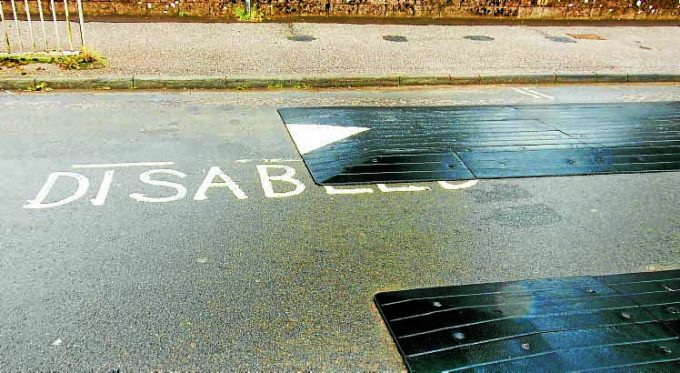 GETTING THE HUMP . . . a traffic calming measure has been erected partially inside a disabled parking bay in Lochside