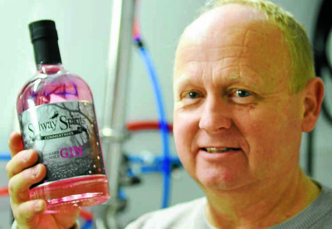 qwd *** Local Caption *** HUGE INTEREST . . . a gin made in a garage in Cummertrees has gone viral on social media. Solway Spirits Rhubarb Crumble flavour has been shared 200,000 times on Facebook, much to the surprise and delight of distiller Andrew Emmerson, pictured. He has converted his garage into a production centre for a range of flavoured gins, ales, vodka and rum