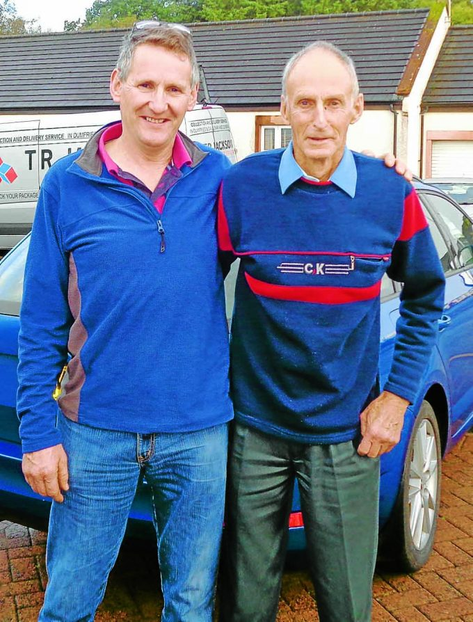 GUEST OF HONOUR . . . legendary fell runner Joss Naylor MBE was the speaker at an event in Johnstonebridge last Friday night. He addressed an audience of like minded fell runners at the do at the community centre organised by Christine Cox. Joss, 81, is pictured with Nigel Priestly, of Lockerbie, as he prepared to leave Annandale to get home to prepare for a run on Sunday at Buttermere
