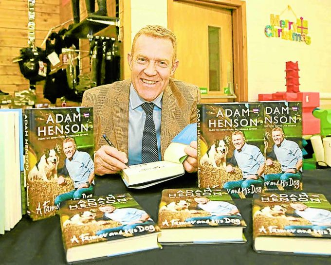 BBC COUNTRYFILE presenter Adam Henson was in Dumfries this week visiting a local business during which time he took the opportunity to sign copies of his latest book