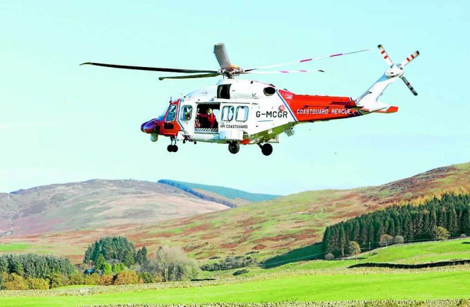 HELICOPTER CREW . . . HM Coastguard helicopter coming in to land in Moffat