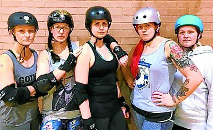 ANGER . . .Lynnette Campbell, centre, and her roller derby girls