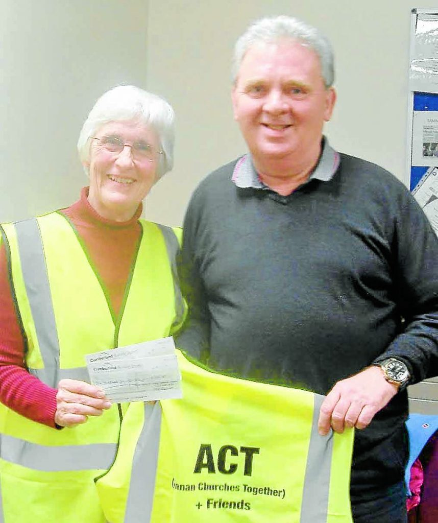 LITTER FUND . . . chairman of Annan Community Council, Allan Weild, is pictured presenting Heather Pail of the All Churches Together and friends group with a cheque for £150. This group was started when a group of people went out for a walk and noticed the litter around the town, and decided to do something to stop the problem. The money is used to buy equipment to assist in the clean up process.