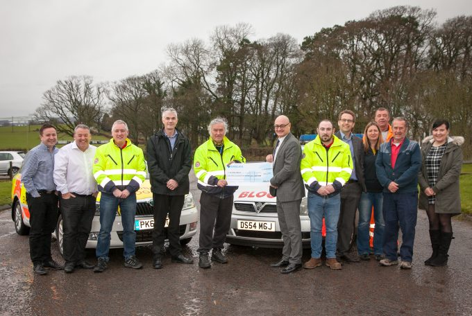Andrew Hayward (Centre) and the Lochmaben team presenting the cheque to Blood Bikes-2