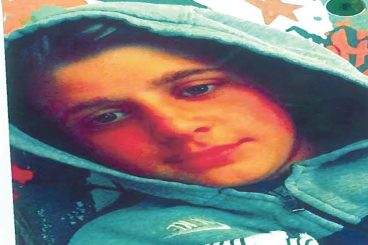 Three charged with murder of boy, 14
