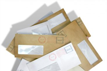 Postman fired as hidden letters found