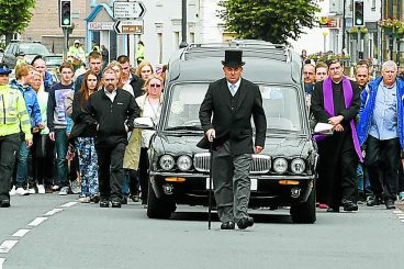 Mourners line streets for Mikey