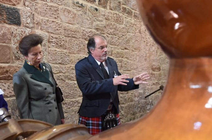 PROCESS . . . Princess Anne hears how the whisky is made