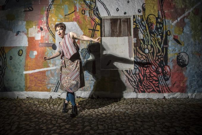 FREE PICTURE:  Rural Mural inspires fashion extravaganza, 24/05/2016: SPRING INTO FASHION: Art and fashion came together to show off fabulous fabrics ahead of the Spring Fling open studios weekend on 28th-30th May (2016).   One of three new Spring Fling Rural Murals (SFRMs) in Dumfries and Galloway was chosen to showcase hand-made silk kimono-style jackets, wrap-round skirts and coats by international textile designer Morag Macpherson. She and Italian international street artist Tellas, were also the creators of the mural, at Meiklewood Farm, Ringford, near Castle Douglas. Pictured is Katarina Marie Kositzki in designer wrap-round silk patterned skirt and waistcoat.  Thousands of visitors will see the murals as they tour the 94 Spring Fling visual arts festival studios, including Morag's. The fashion shoot project was led by photographer Kim Ayres, a regular Spring Fling participant. The models were Jessica Leeand Katarina Marie Kositzki, with hair and makeup by Basement 20, Dumfries. For further details on Spring Fling please visit www.spring-fling.co.uk More information from:  Matthew Shelley, PR consultant for Spring Fling / Rural Mural - 07786 704 299 - MJHShelley@hotmail.co.uk Photography by Kim Ayres - 07971 969 953 - kimayres@gmail.com - www.kimayres.co.uk