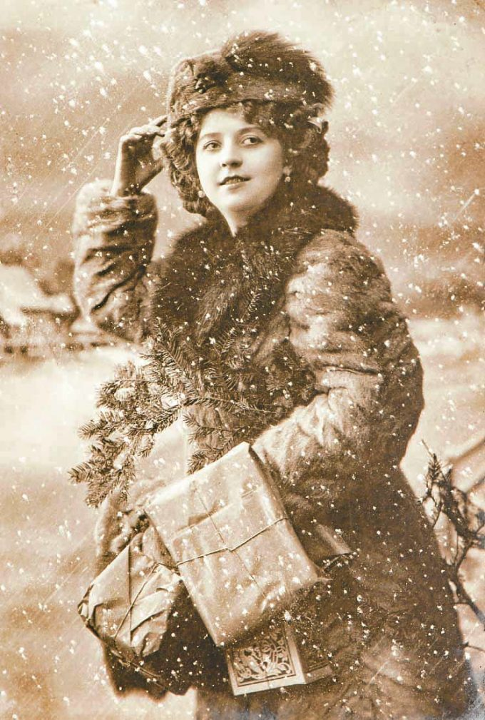 Young woman with christmas tree and gifts. Vintage picture