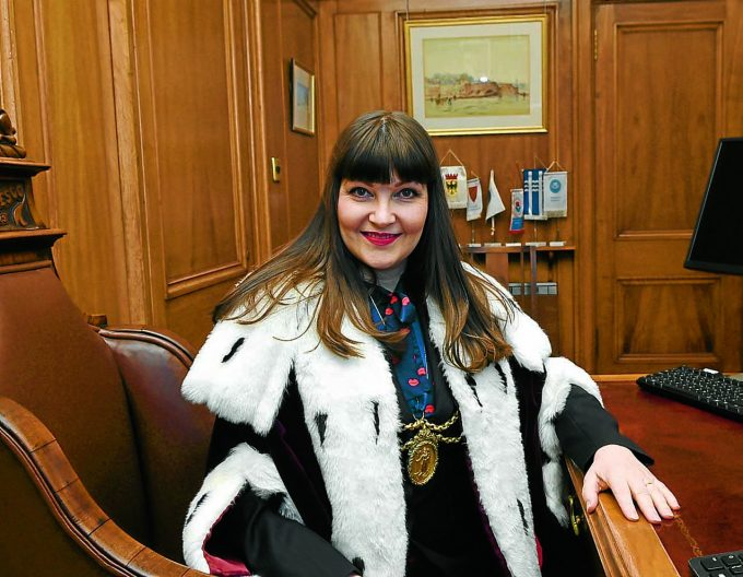 HOT SEAT . . . Tracey Little shares the same office and desk as the many Provosts that came before her *** Local Caption *** HOT SEAT . . . Tracey Little shares the same office and desk as the many Provosts that came before her