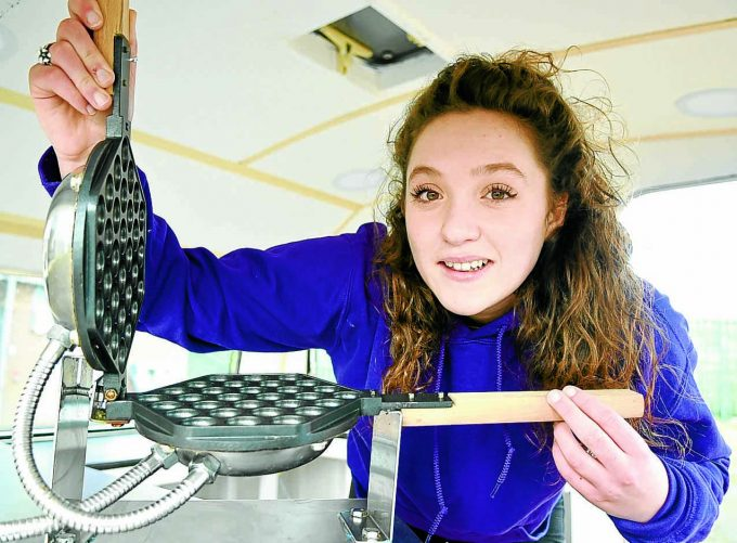HOT STUFF . . . Megan Birley shows off her unique bubble waffle iron  *** Local Caption *** HOT STUFF . . . Megan Birley shows off her unique bubble waffle iron