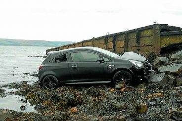 Woman rescued after car sea plunge