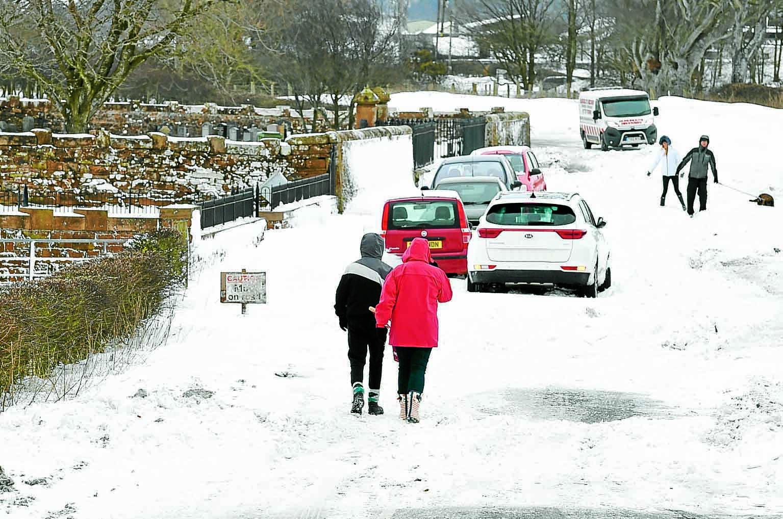 Village snow storm cars abandoned