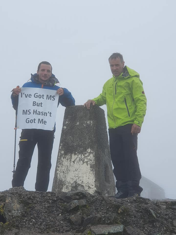 Adam is on top of the world after peak challenge