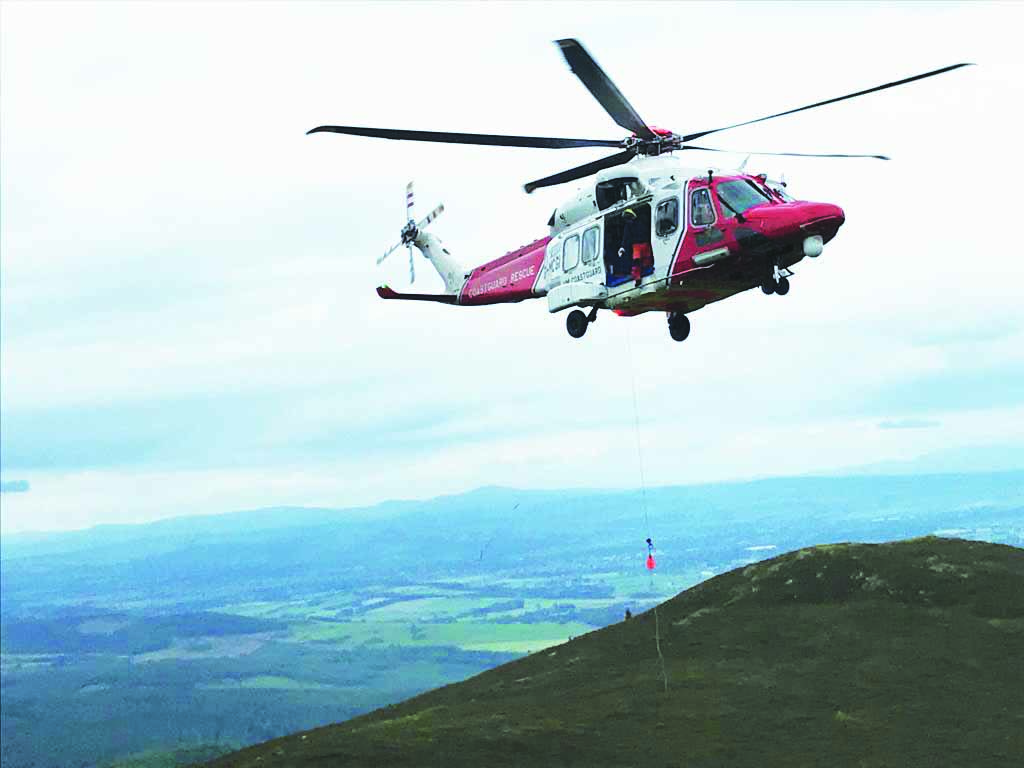 Walker in hill helicopter rescue